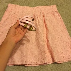 Pink lace skirt with matching belt with gold bow